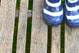Blue Striped Rain Boots on a Wooden Floor