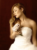 Woman in Wedding Dress with White Rose