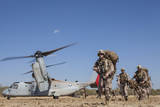 Marines and Sailors Offload from a MV-22 Osprey