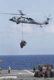 An Mh-60S Sea Hawk Picks Up Cargo from USNS Medgar Evers