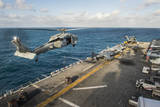 An Mh-60S Sea Hawk Helicopter Delivers Supplies to USS Bonhomme Richard