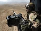 Door Gunner Scans the Terrain over Afghanistan