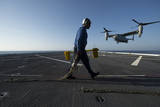 Aviation Boatswain's Mate Prepares to Chock and Chain an MV-22 Osprey