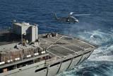 An Mh-60S Sea Hawk Conducts a Vertical Replenishment with USNS Rainier