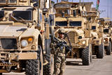 US Army Soldier Stands Local Security Near Armored Convoy Vehicles