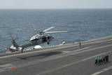 An Mh-60S Sea Hawk Lands on the Flight Deck of USS Nimitz