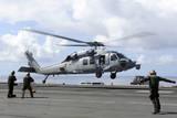 An Mh-60S Sea Hawk Lands on the Flight Deck of USS John C Stennis