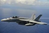 An F-A-18E Super Hornet over the Pacific Ocean