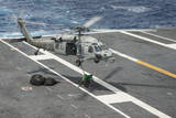 Sailors Connect Cargo Legs and Nets to an Mh-60S Sea Hawk