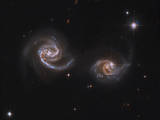 A Pair of Interacting Spiral Galaxies with Swirling Arms