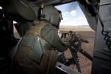 A Hh-60G Pave Hawk Gunner Fires His Gau-17 Machine Gun
