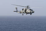 An Mh-60R Sea Hawk Helicopter Flies over the Gulf of Oman