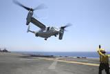 Airman Directs the Take-Off an MV-22 Osprey