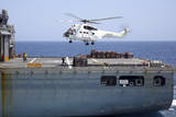 An SA-330J Puma Helicopter Delivers Supplies to USS Kearsarge