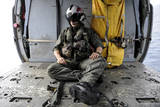 A Search and Rescue Swimmer Sits in the Back of an Mh-60S Sea Hawk