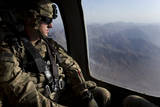 US Army Soldier Looks Out the Window of a Uh-60 Black Hawk Helicopter