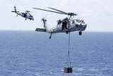 Mh-60S Sea Hawk Helicopters Conduct a Vertical Replenishment