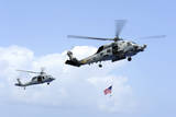 An Mh-60S Sea Hawk Helicopter Follows Behind an Mh-60R Sea Hawk