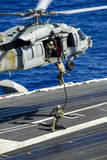 Sailors Conduct a Fast-Rope Exercise from an Mh-60S Sea Hawk
