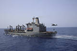 An Mh-60S Sea Hawk Conducts a Vertical Replenishment with USNS Laramie