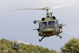 Two Italian Air Force Ab-212 Ico Helicopters Practice Low Level Flying