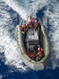 Sailors Conduct Man Overboard Training in a Small Boat