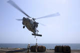 Marines Hook Cargo to an Mh-60S Sea Hawk Helicopter