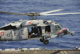 An Mh-60S Sea Hawk Prepares to Land on the Flight Deck of USS Nimitz