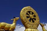 Golden Wheel of Dharma and Deer Sculptures