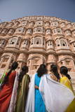 Women in Traditional Dress Standing in Front of the Palace of the Winds (Hawa Mahal)