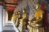 Gold Buddha Statues in Wat Arun (The Temple of Dawn)  Bangkok  Thailand  Southeast Asia  Asia
