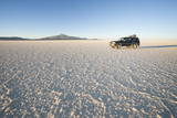Jeep Traveling across Salt Flats at Sunset  Salar De Uyuni  Bolivia  South America