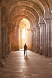 A Lady Slowly Walks Down an Aisle in the Basilique Sainte-Marie-Madeleine of Vezelay