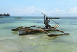 Fisherman and Traditional Outrigger Boat