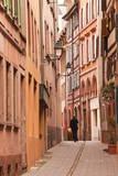 A Man Walks Through La Petite France