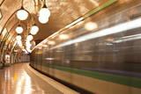 A Paris Metro Train Leaves Cite Station  Paris  France  Europe