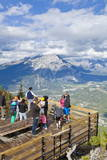 Visitors on a Viewing Platform on Sulphur Mountain Summit Overlooking Banff National Park