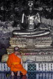 A Monk Prays in Front of a Golden Buddha  Wat Suthat  Bangkok  Thailand  Southeast Asia  Asia