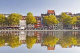 Houses and Shops Reflecting in a Pond  Cologne  North Rhine-Westphalia  Germany  Europe