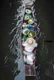 A Vendor Paddles their Boat  Damnoen Saduak Floating Market  Thailand  Southeast Asia  Asia