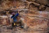A Woman Climbs Gunsmoke V3 in Joshua Tree National Park