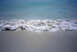 Ocean Waves Break on a Sandy Beach