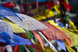 Colorful Prayer Flags Flutter in the Wind on a Himalayan Mountain