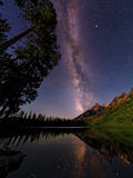 The Beautiful Milky Way  Far from City Light Pollution  Reflected in a Calm Body of Water