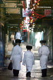 Ultra-Orthodox Jewish Rabbis Walking Through the Old City Streets in Jerusalem  Israel