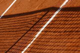A Net Casts its Shadow on a Court at the French Open Tennis Tournament at Roland Garros in Paris
