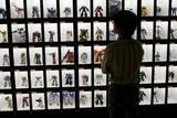 Japanese Visitor Looks at Gandam Robot Dolls on Display in Tokyo  Japan