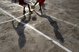 Indonesian Boys Play Soccer at Slum Area in Jakarta  Indonesia