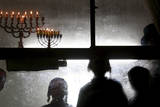 Religious Jews in Beitar Illit Settlement Light Channukah Candles