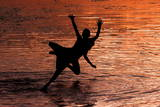 Kashmiri Boys Jump into Dal Lake to Beat the Heat as Sun Sets in Srinagar